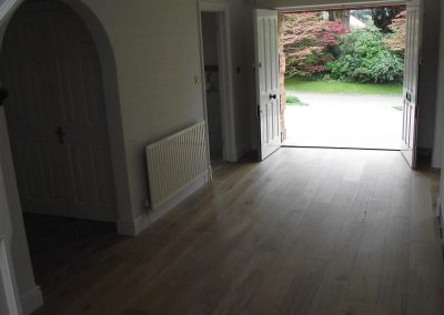 008_DPM_damp_proof_membrane_installation_rubber_based_adhesive_engineered_floor_boards_prefinished_wood_flooring_Surrey