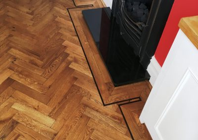 013_single_dark_strip_double_block_frame_distressed_rustic_parquet_oak_Surrey_Epsom_heritage.jpg